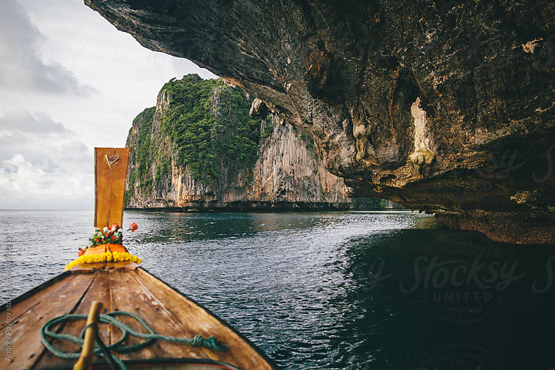 Boat in cave on water by Andrey Pavlov for Stocksy United