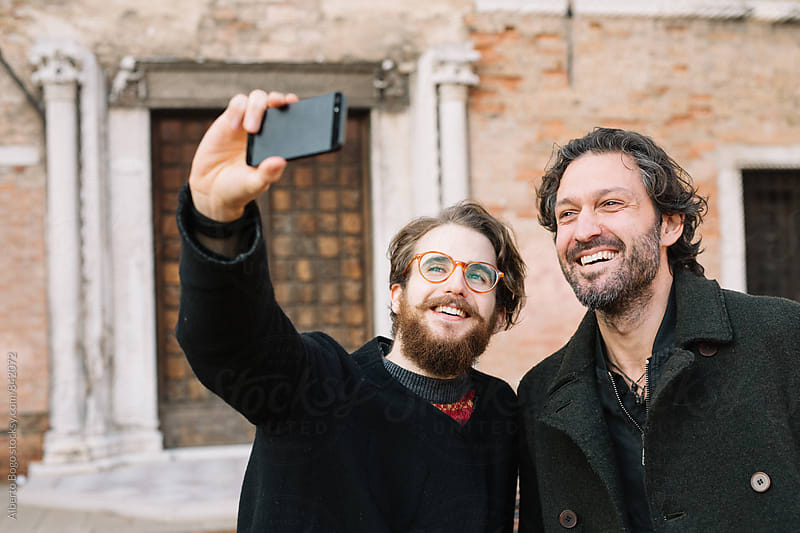Best Friends Taking A Self Portrait in the city by Alberto Bogo for Stocksy United