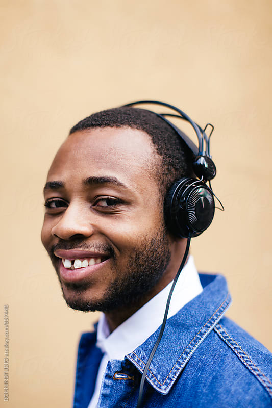 Portrait of an african american man listening music with headphone. by BONNINSTUDIO for Stocksy United