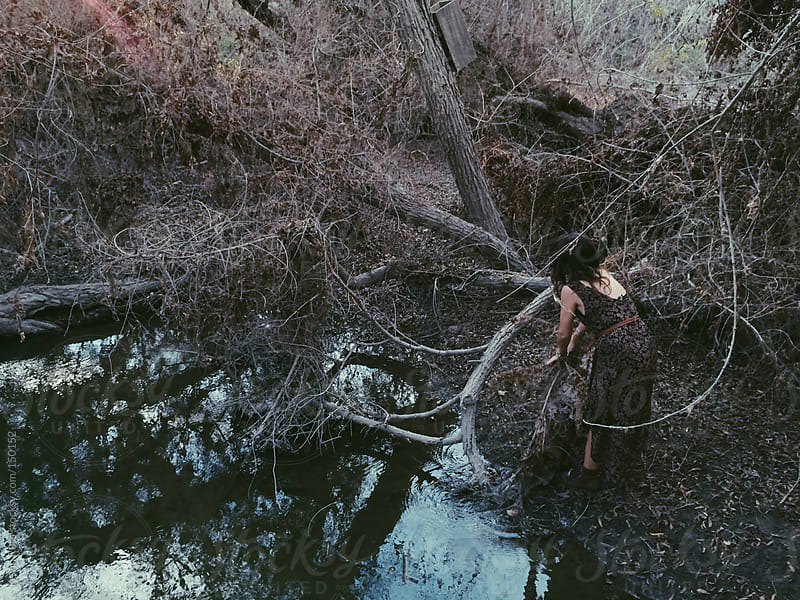 Woman by Forest Swamp by Kevin Russ for Stocksy United