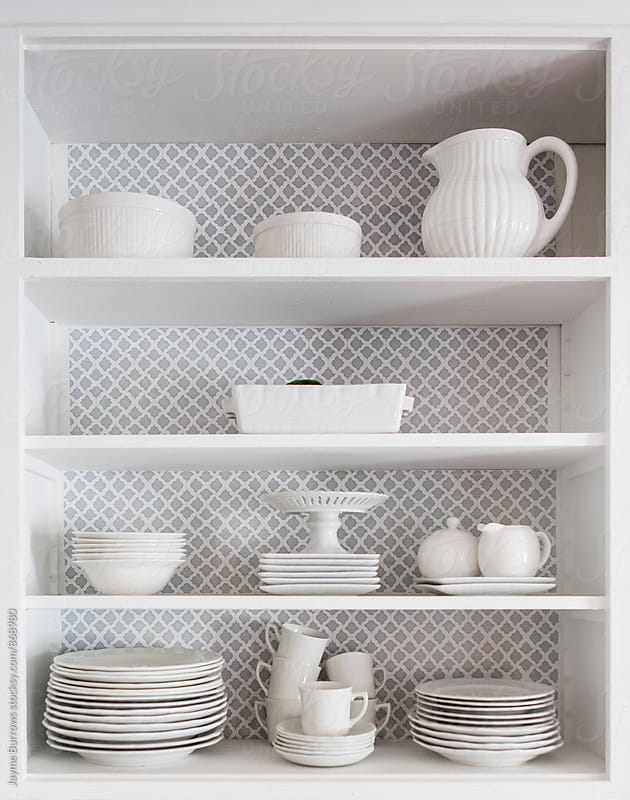 White Dishes Stacked Neatly by Jayme Burrows for Stocksy United
