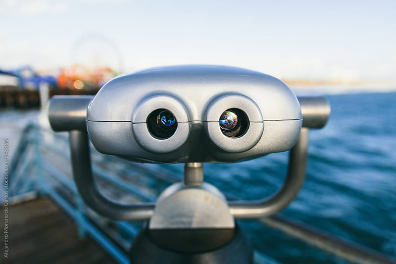 Binoculars on a pier by Alejandro Moreno de Carlos for Stocksy United