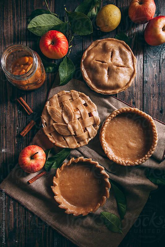 Preparing apple pies for baking by Nataša Mandić for Stocksy United
