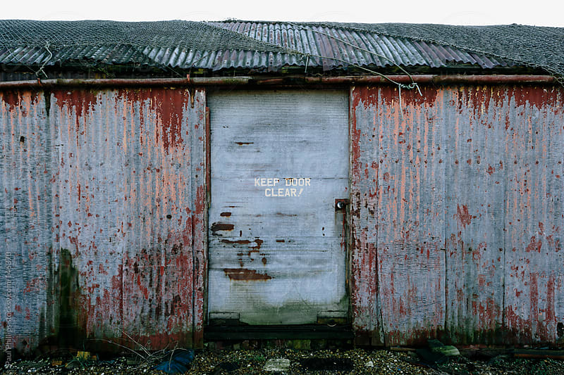 Old building with Keep Door Clear sign by Paul Phillips for Stocksy United