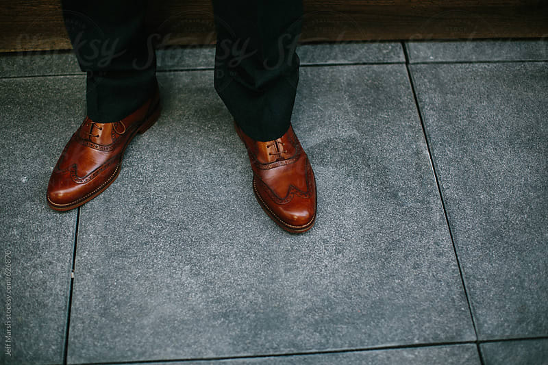 Man in brown shoes by Jeff Marsh for Stocksy United