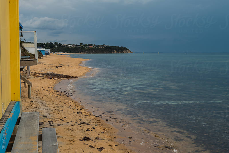 storm clouds at the beach, view from a beach box, Victoria, Australia by Gillian Vann for Stocksy United