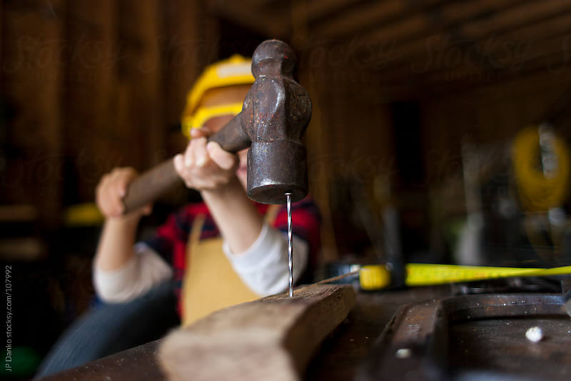 Little Boy in Garage With Hammer by JP Danko for Stocksy United