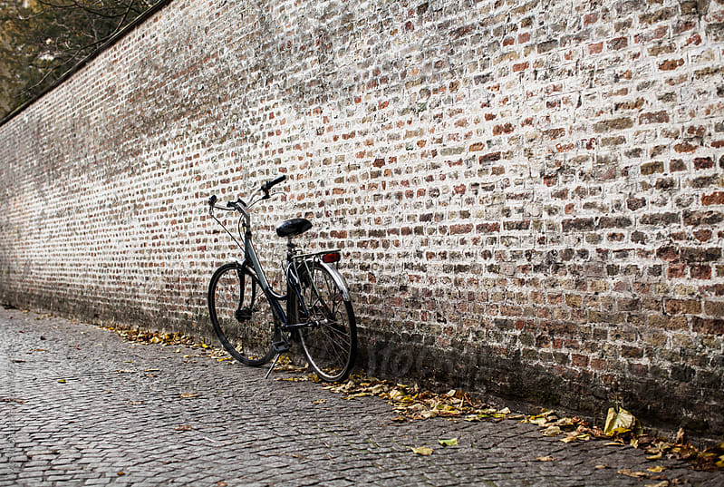 Bicycle Parked by the Big Brick Wall  by Mosuno for Stocksy United
