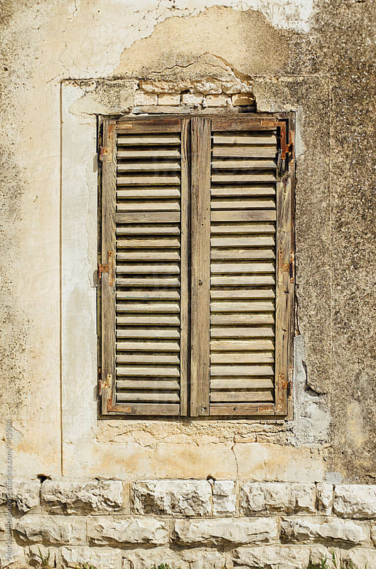 Window detail on old house by Marko Milovanović for Stocksy United