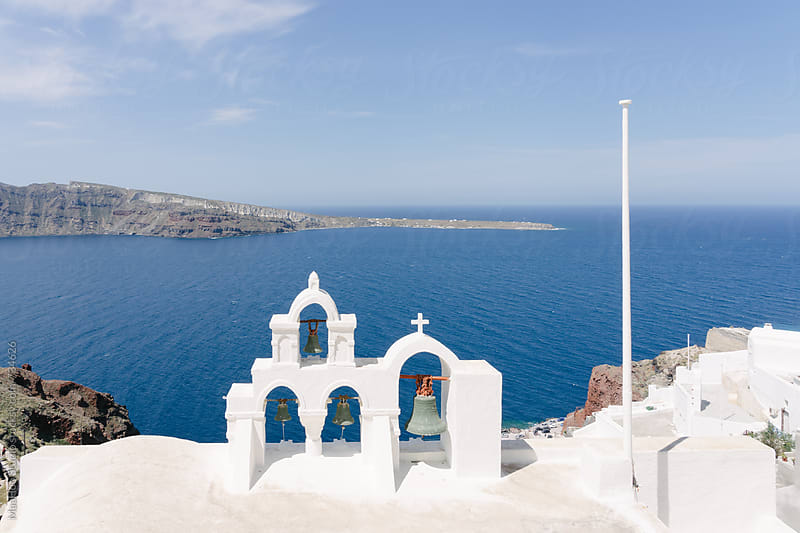 View of sea and white washed church bell tower, Oia, Santorini, Cyclades, Greece by Maa Hoo for Stocksy United