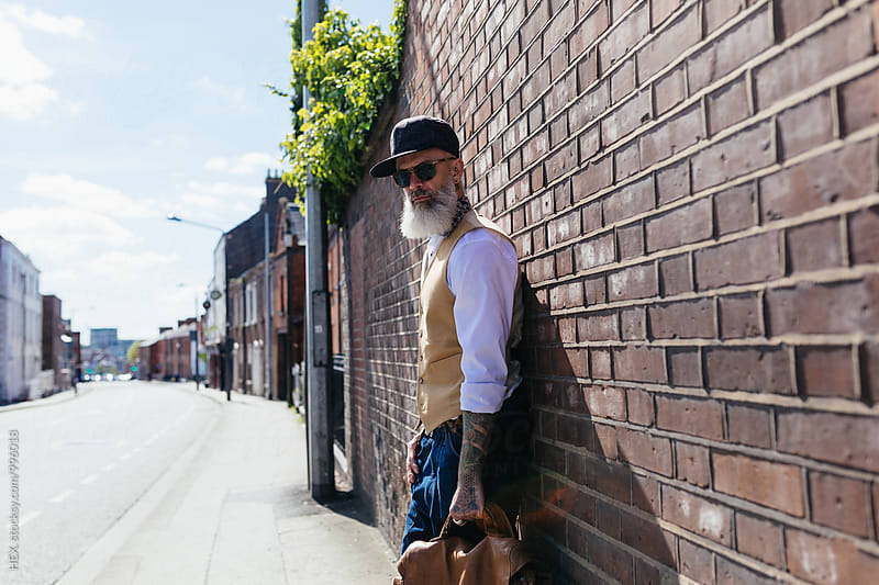 Eccentric Stylish Man Portrait in the City by HEX. for Stocksy United
