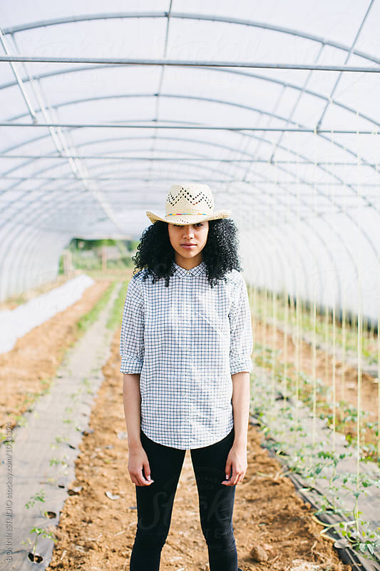 Portrait of an entrepreneur woman in a big greenhouse. by BONNINSTUDIO for Stocksy United