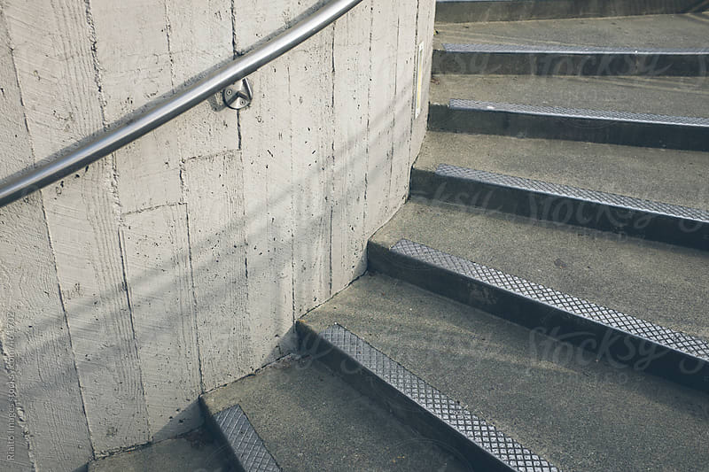 Concrete stairs and metal handrail by Paul Edmondson for Stocksy United