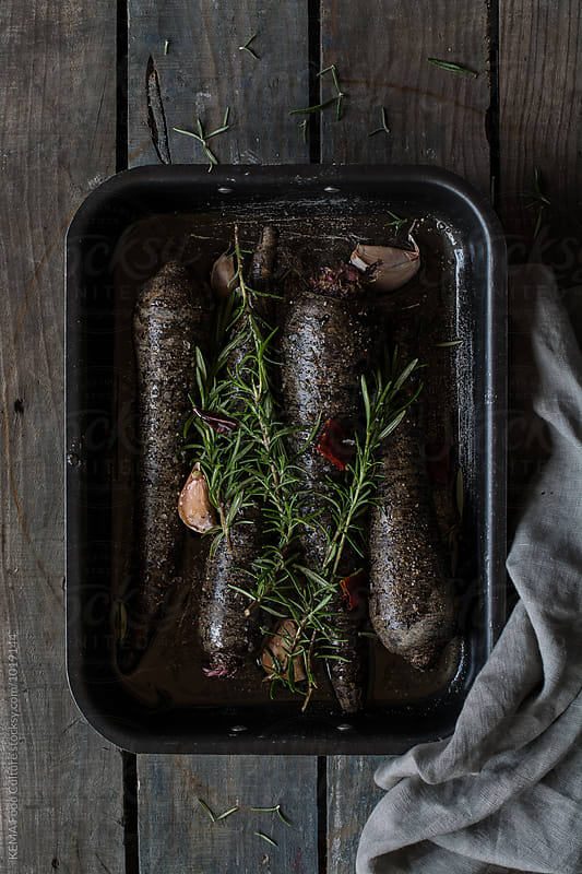 Black carrots on a baking sheet by KEMA Food Culture for Stocksy United