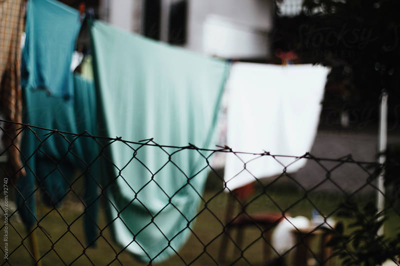 Clothes drying in the garden by Jovana Rikalo for Stocksy United