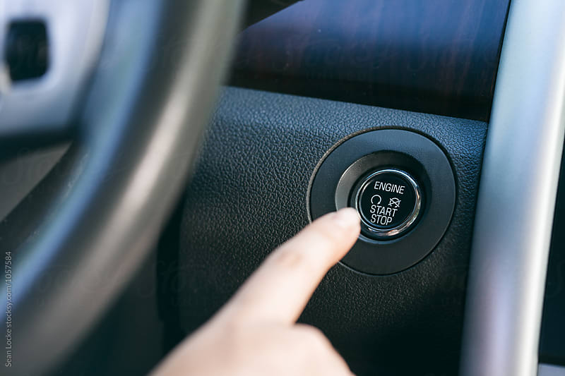 Driving: Teen Girl Pushing Ignition Start Button by Sean Locke for Stocksy United