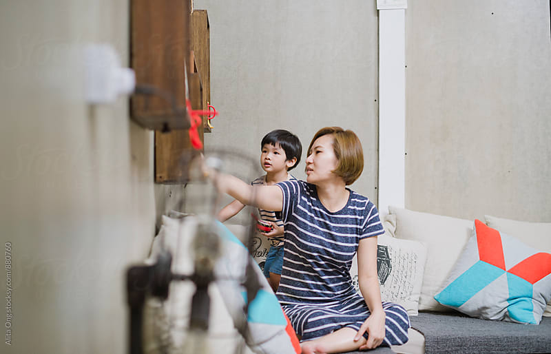 Family spending time together at a living room by Alita Ong for Stocksy United