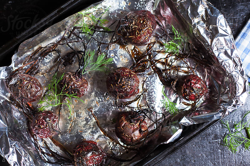 Roasted beets with herbs. by Darren Muir for Stocksy United
