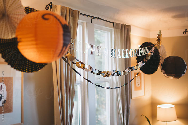 Halloween decorations inside by Rob and Julia Campbell for Stocksy United