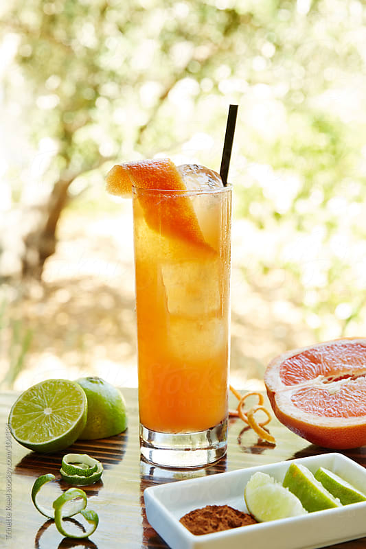 Rum cocktail drink with cinnamon syrup, lime, grapefruit and absinthe  by Trinette Reed for Stocksy United
