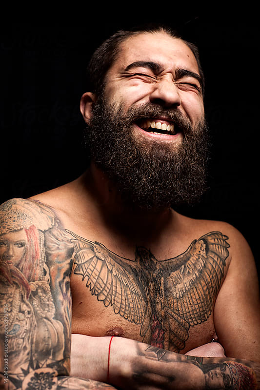 Portrait of a bearded man laughing by MEM Studio for Stocksy United