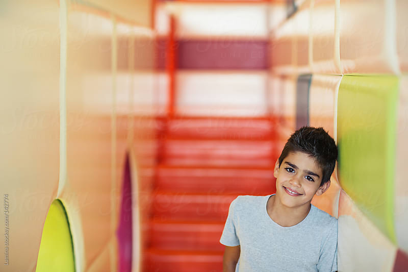 Smiling Boy at a Playroom by Lumina for Stocksy United