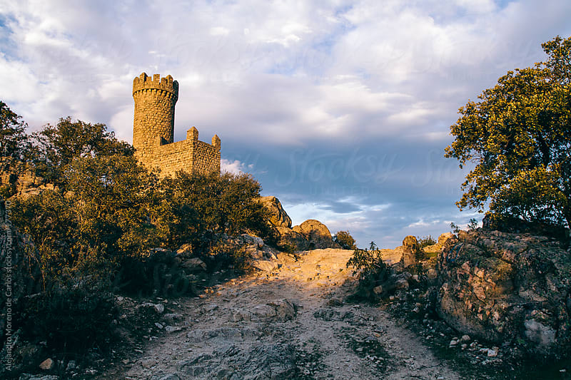 Castle medieval tower at sunset by Alejandro Moreno de Carlos for Stocksy United