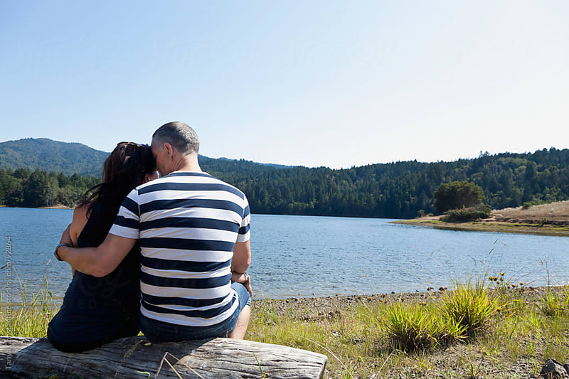 mature couple hugging - outdoors by Tanya Constantine for Stocksy United