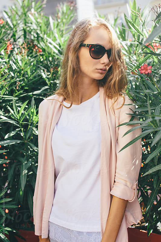 Portrait of young blonde woman in sunglasses by Andrey Pavlov for Stocksy United