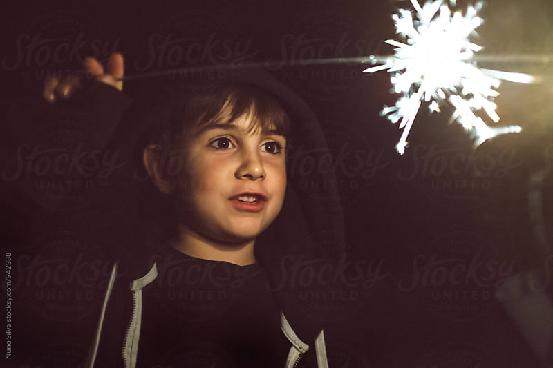 Sparkler Boy by Nuno Silva for Stocksy United