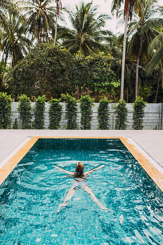 Woman Swimming in a Swimming Pool by Lumina for Stocksy United