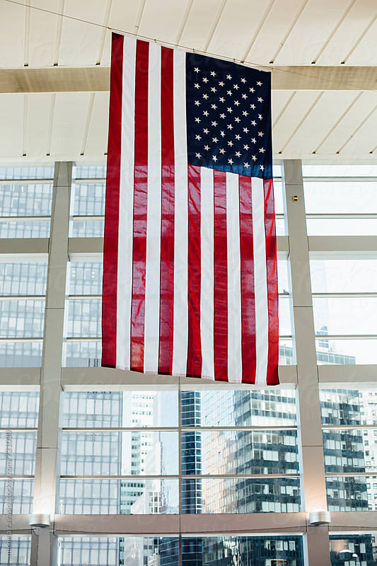 American flag hanging in a building by michela ravasio for Stocksy United