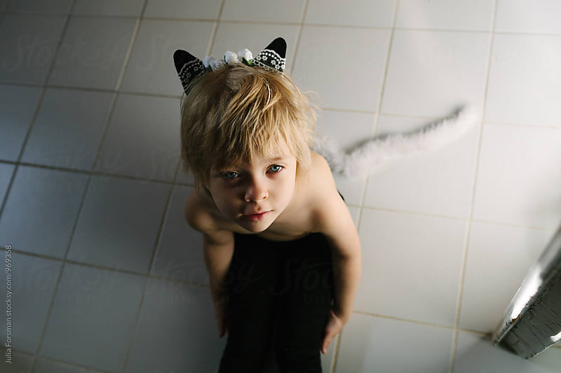 Little  blonde girl with cat ears and tail. by Julia Forsman for Stocksy United