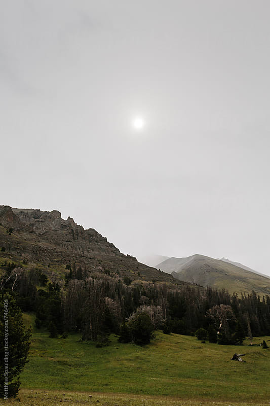 Mountain landscape with sun on a hazy day by Matthew Spaulding for Stocksy United