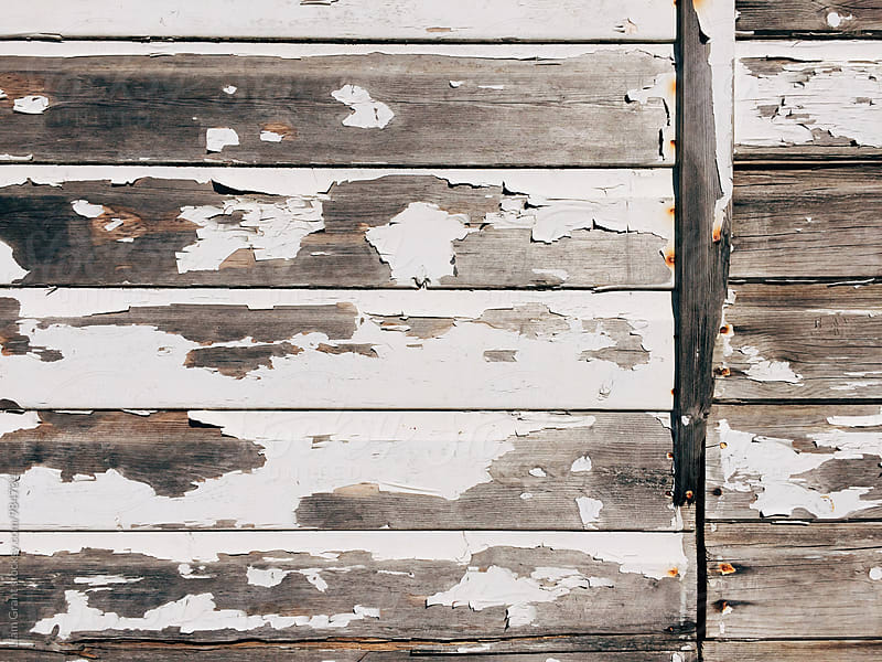 Flaking paint on a wooden panelled beach hut. Norfolk, UK. by Liam Grant for Stocksy United