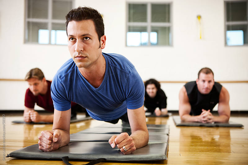 Gym: Men Planking in Exercise Class by Sean Locke for Stocksy United