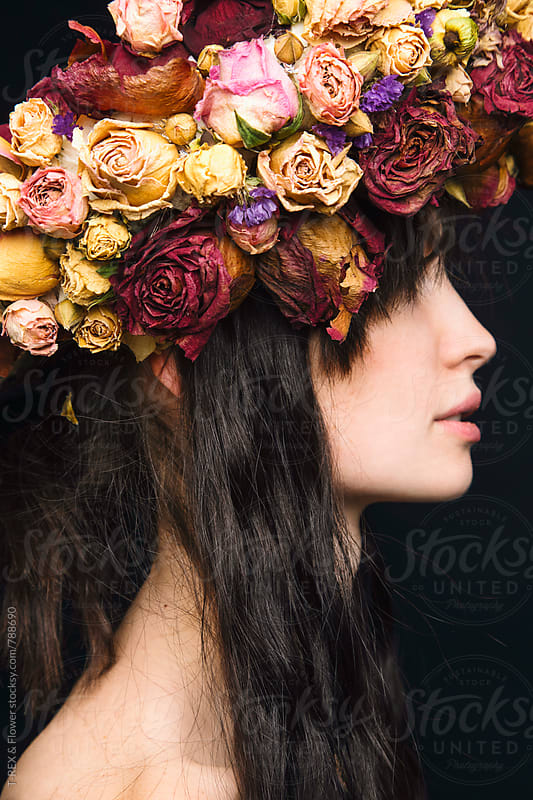 Close-up of young woman wearing dried flower wreath by Danil Nevsky for Stocksy United