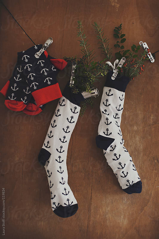 Christmas hipster stocking decorated with anchors and filled with headphones and match carrier by Laura Stolfi for Stocksy United