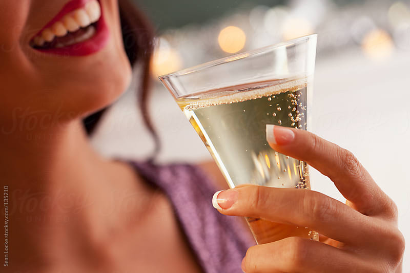 New Year: Woman Laughing With Glass of Champagne by Sean Locke for Stocksy United