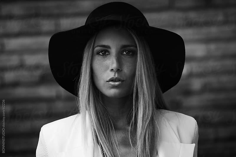 Portrait of fashion young woman. Black and white photo. by BONNINSTUDIO for Stocksy United