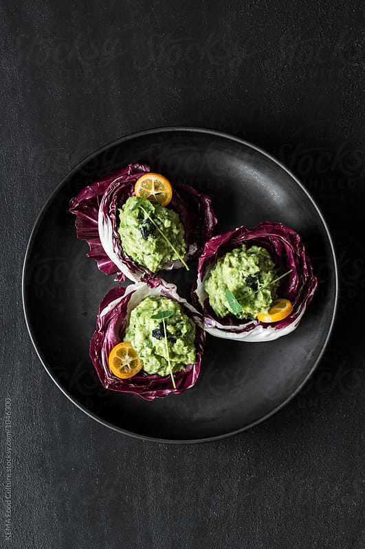Chicory stuffed with guacamole by KEMA Food Culture for Stocksy United