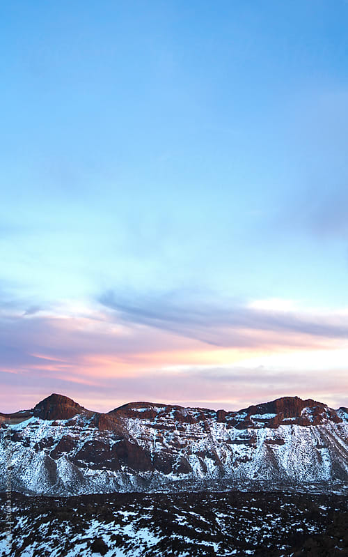 Snowy mountains at sunset by ACALU Studio for Stocksy United