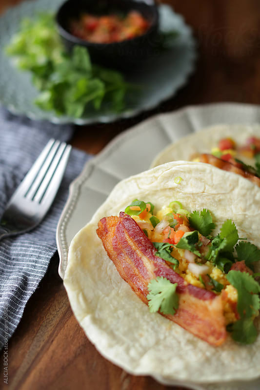 An Egg and Bacon Breakfast Taco With Cilantro and Scallions by ALICIA BOCK for Stocksy United