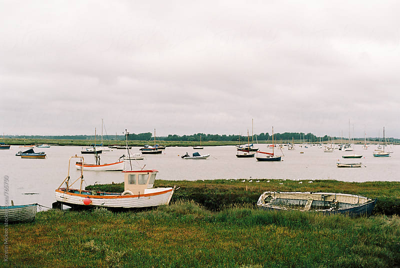 Boats in a bay, Aldeburgh by Kirstin Mckee for Stocksy United