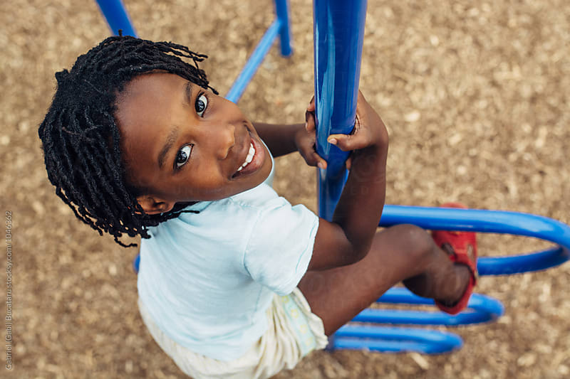 African American child climbing at a playground by Gabriel (Gabi) Bucataru for Stocksy United