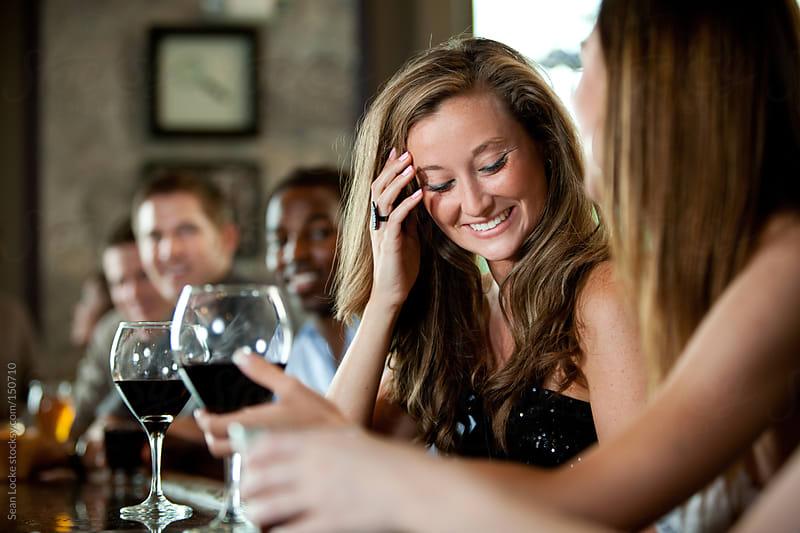 Bar: Woman Shy About Man Flirting by Sean Locke for Stocksy United