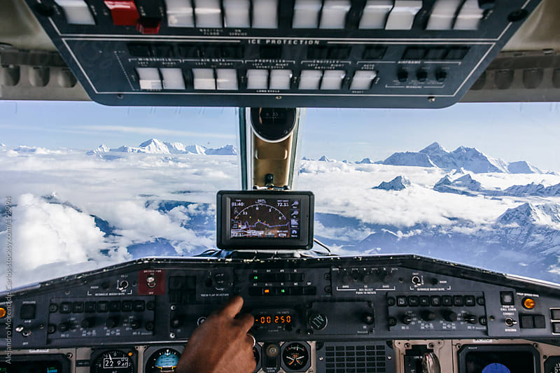 Airplane control cabin on a flight over Himalaya mountain range with Mount Everest on the background by Alejandro Moreno de Carlos for Stocksy United