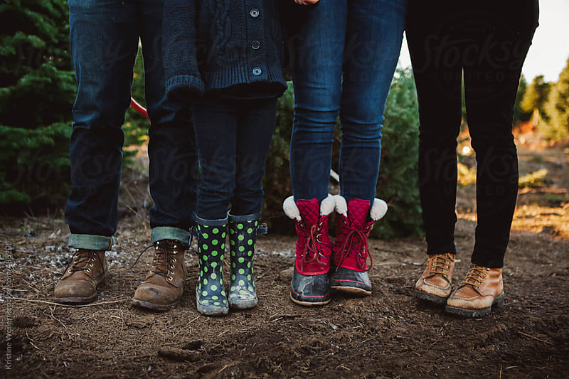 The Feet of a Family of Four by Kristine Weilert for Stocksy United
