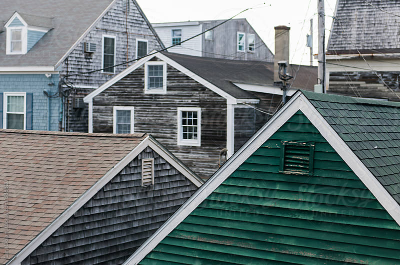 Crowded rooftops in an old Maine fishing village by Cara Slifka for Stocksy United