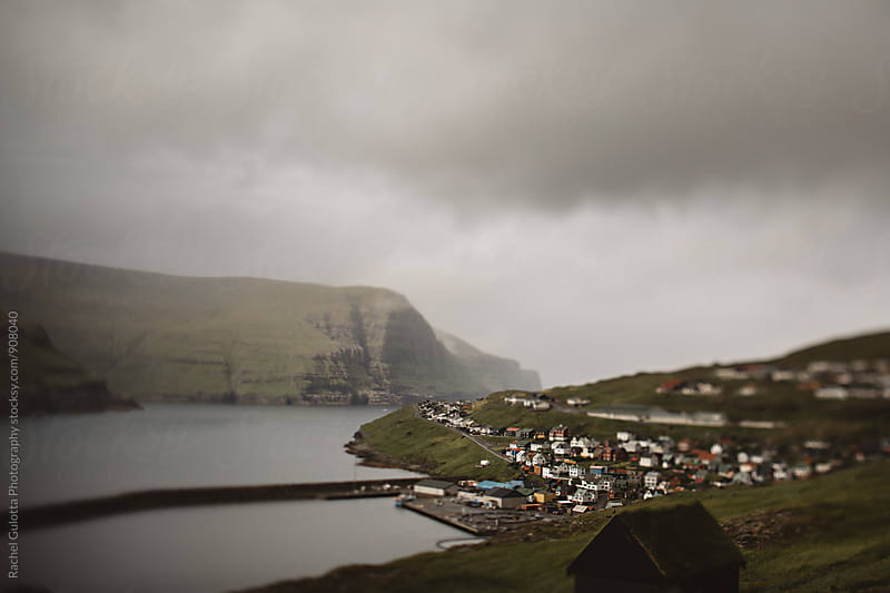 A Tilt Shift Photo of a Village on the Edge of a Cliff and the Ocean by Rachel Gulotta Photography for Stocksy United